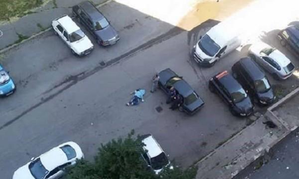 Вторник сутрин, люлински блок... Тяло на мъж на паркинга