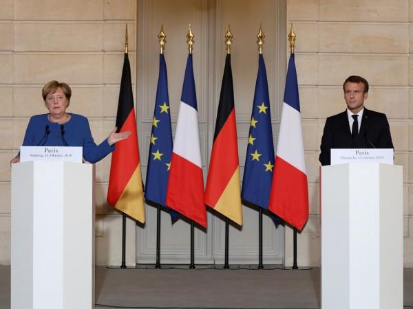 Bренският президент Еманюел Макрон и германската канцлерка Ангела Меркел отправиха