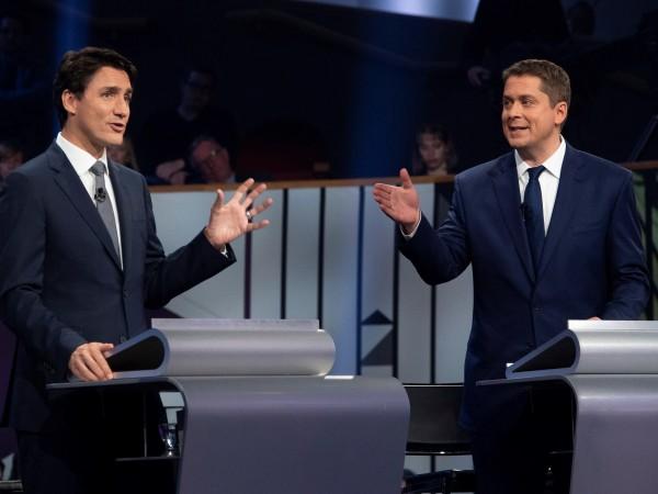 Канадците днес гласуват на парламентарни избори, като социологическите допитвания предсказват,