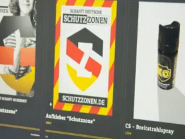 Трима мъже от германската Националдемократична партия патрулират по улиците на