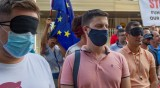 Със затворени очи протестиращи искат реакция от Берлин